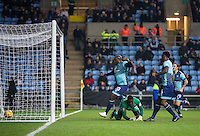 Adebayo Akinfenwa of Wycombe Wanderers races to retrieve the ball to restart after scoring his goal as Wycombe pull a goal back during the The Checkatrade Trophy - EFL Trophy Semi Final match between Coventry City and Wycombe Wanderers at the Ricoh Arena, Coventry, England on 7 February 2017. Photo by Andy Rowland.