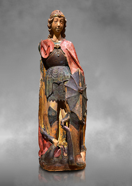Gothic terracotta statue of the Archangel Gabriel attributed to Lorenzo Mercadante de Bretanya of Seville, circa 1460, from the convent of Santa Clara de Fregenal de la Sierra, Badajoz..  National Museum of Catalan Art, Barcelona, Spain, inv no: MNAC  4367. Against a grey art background.