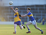 Cian Mc Donagh of  Clare  in action against Jamie Holloway of  Tipperary during their Munster Minor football semi-final at Thurles. Photograph by John Kelly.