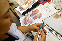 A technician sculptures prothetic fingers in the work-shop made from silicon at Hello Tomorrow Clinic in Tokyo, Japan. The clinic specializes in making false fingers to Japanese gangsters, known as the Yakuza, who have had to show allegiance etc by cutting their own fingers off.  The clinic has made and fitted fingers to over 3,000 gang members who need to disguise thier back-ground.<br /> 10-Oct-2006