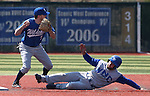 Former Wildcat Andrew Garcia turns the double play against Jack Hall during the alumni game at Western Nevada College in Carson City, Nev., on Saturday, Sept. 7, 2013. The Wildcats defeated the Alumni 7-1.  <br /> Photo by Cathleen Allison/Nevada Photo Source