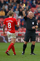 (L-R) Adam Clayton of Middlesbrough sees a yellow card by referee Simon Hooper during the Sky Bet Championship match between Middlesbrough and Swansea City at the Riverside Stadium, Middlesbrough, England, UK. Saturday 22 September 2018