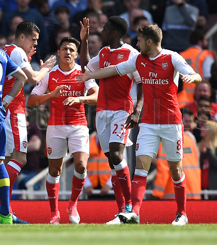 May 21st 2017, Emirates Stadium, Highbury London England; EPL Premier league football, Arsenal versus Everton; Alexis Sanchez, Forward for Arsenal is congratulated by team mates after scoring the second goal