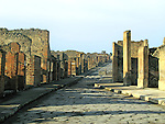 A paved street and ruins at the city of Pompeii - buried by a volcano in 79 A.D.