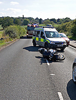 Firefighters and Warwickshire rapid response ambulance paramedic at the scene of an RTC involving a motorcyclist. This image may only be used to portray the subject in a positive manner..©shoutpictures.com..john@shoutpictures.com