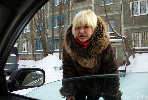 A prostitute solicits clients in Murmansk City, the biggest Arctic city on earth. While the region is full of resources such as metals, oil and gas, the population lives poorly. .
