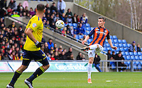 Dan Potts of Luton Town with a lobbed pass during the Sky Bet League 2 match between Oxford United and Luton Town at the Kassam Stadium, Oxford, England on 16 April 2016. Photo by Liam Smith.
