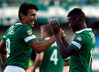 CALI -COLOMBIA-03-08-2014. Carlos Rivas (Der) jugador del Deportivo Cali celebra con Sergio Herrera (Izq) el gol anotado al Deportivo Pasto durante partido por la fecha 3 de la Liga Postobón II 2014 jugado en el estadio Pascual Guerrero de la ciudad de Cali./  Carlos Rivas (R) player of Deportivo Cali celebrates with Sergio Herrera (L) the goal scored to Deportivo Pasto during match for the 3th date of Postobon League II 2014 played at Pascual Guerrero stadium in Cali city Photo: VizzorImage/Juan C. Quintero/STR