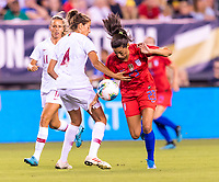 PHILADELPHIA, PA - AUGUST 29: Silvia Rebelo #4 of Portugal fights for the ball with Christen Press #23 of the United States during a game between Portugal and the USWNT at Lincoln Financial Field on August 29, 2019 in Philadelphia, PA.