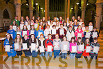 YOUNG: Pupils from Presentation & Moyderwell Primary schools, Tralee who wereenrolled as junior pioneers in St John's Church, Tralee on Saturday night, by Spiriritual Director Fr Kieran O'Brien and Maurice O'Connor (Fr Cullen Medal) Tralee. Back l-r: Riona Sayers (Silver pin 25years,Derryquay), John Cooke PTAA),Rosaleen Mangan (St Brendan Park), Sheila O'Sullivan (Gold Pin,Tralee), Chris Griffin Tralee who collected the gold pin on behalf of her sister Kathgleen Glavin who's in Canada) and Liam Fitzgerald (Tralee,Gold pin)...