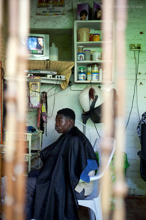 12 januay 2011 - Juba, South Sudan - A man sits at a barber shop as ballots are counted following a weeklong independence referendum in Juba, the capital of Southern Sudan. Photo credit: Benedicte Desrus