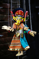Nepalese puppets are hand-made, with the carved, wooden faces usually originating in Bhaktapur, a local industry.