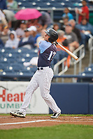 Trenton Thunder center fielder Jeff Hendrix (17) follows through on a swing during a game against the New Hampshire Fisher Cats on August 19, 2018 at ARM & HAMMER Park in Trenton, New Jersey.  New Hampshire defeated Trenton 12-1.  (Mike Janes/Four Seam Images)