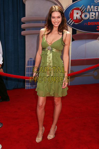 "KIM SMITH .""Meet The Robinsons"" Los Angeles Premiere at the El Capitan Theatre, Hollywood, California, USA..March 25th, 2007.full length green dress ruffles ruffles ribbon belt .CAP/ADM/BP.©Byron Purvis/AdMedia/Capital Pictures"