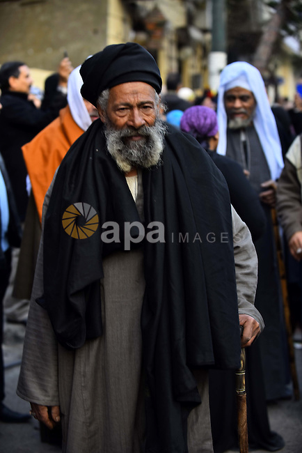"""Egyptian Sufi Muslims chant prayers while walking in a march with banners as they celebrate """"Mawlid al-Nabawi"""" or the birth of Prophet Mohammad in Al Azhar district, old Cairo, December 23, 2015. Photo by Amr Sayed"""