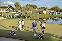 Rory McIlroy (NIR) and Matt Fitzpatrick (ENG) depart the green on 18 following round 4 of the Arnold Palmer Invitational at Bay Hill Golf Club, Bay Hill, Florida. 3/10/2019.<br /> Picture: Golffile | Ken Murray<br /> <br /> <br /> All photo usage must carry mandatory copyright credit (© Golffile | Ken Murray)