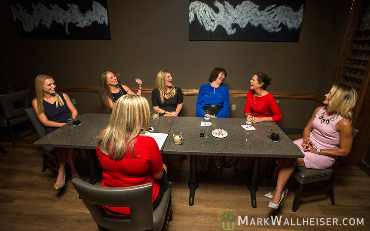 Lobbyist, from left, Samantha Sexton, Monica Rodriguez, Andrea Reilly, Keyna Cory, Jan Gorrie and Sarah Busk  react to questions by moderator Christina Johnson,foreground, as they participate during a Florida Women Lobbyist round table at the Blue Halo Restaurant in Tallahassee, Florida.