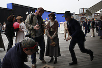 "NEW YORK - APRIL 13: Director Simon Cellan Jones, left, directs actress Aleksa Palladino, center, as actor Michael Pitt runs by, during filming of an episode of the new HBO series ""Boardwalk Empire"" on their Atlantic City Boardwalk set on Tuesday, April 13, 2010, in Brooklyn, New York.  The drama series, conceived by Terence Winter, an Emmy Award winning writer of The Sopranos, and Academy Award winning director Martin Scorcese, is set in Atlantic City during the dawn of prohibition, when the sale of alcohol became illegal throughout the United States.(Photo by Landon Nordeman)"