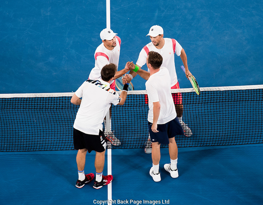 Mike and Bob Bryan of the USA congratulate John Peers of Australia and Henri Kontinen of Finland  during Day Thirteen of the Australian Open Tennis Championships held in Melbourne Park, Australia on 28th January 2017