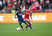 21 April 2012: Chicago Fire forward Patrick Nyarko #14 and Toronto FC midfielder Terry Dunfield #23 in action during the first half in a game between the Chicago Fire and Toronto FC at BMO Field in Toronto...