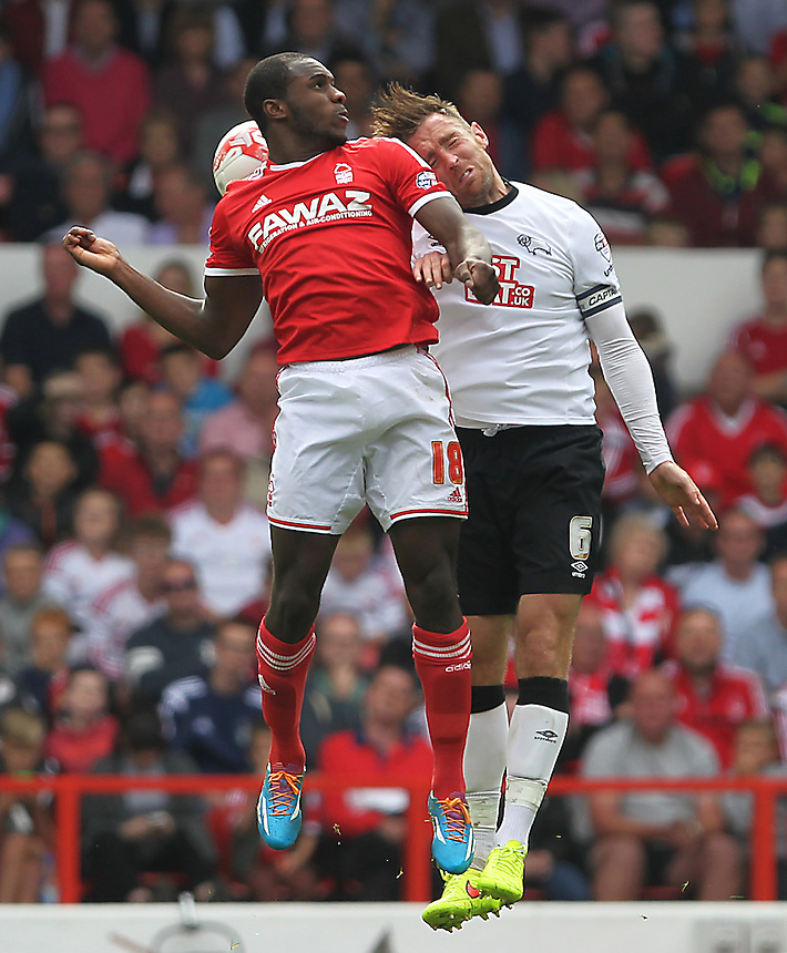 Derby County's Richard Keogh jumps with Nottingham Forest's Michail Antonio<br /> <br /> Photographer Mick Walker/CameraSport<br /> <br /> Football - The Football League Sky Bet Championship - Nottingham Forest v Derby County - Sunday 14th September 2014 - The City Ground - Nottingham<br /> <br /> &copy; CameraSport - 43 Linden Ave. Countesthorpe. Leicester. England. LE8 5PG - Tel: +44 (0) 116 277 4147 - admin@camerasport.com - www.camerasport.com