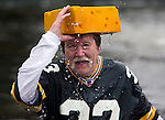 Ken Kietter adjusts his cheesehead after jumping into the Burley Lagoon during the 24th annual Polar Bear Jump in Olalla, Washington on January 1, 2008. This was Kietter's eight year of jumping into the lagoon on New Years Day. Jim Bryant Photo. ©2010. ALL RIGHTS RESERVED.