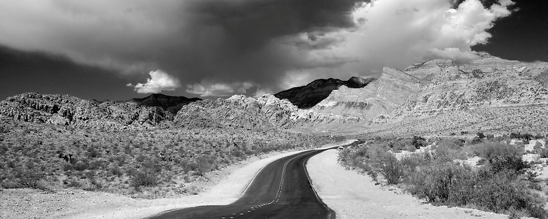 Road and thunderstorm clouds with Rock formations in Red Rock Canyon National Conservation Area, Nevada