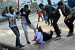 Supporters of the ruling Bangladesh Awami League beat a lawyer and supporter of the main opposition Bangladesh Nationalist Party (BNP) during a protest by opposition activists in Dhaka, Bangladesh.