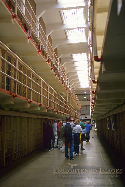 Tourists visiting the prisoner jail cell blocks on Alcatraz, San Francisco, California