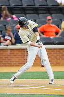 Luke Czajkowski (26) of the Wake Forest Demon Deacons makes contact with the baseball during the game against the Virginia Cavaliers at Wake Forest Baseball Park on May 17, 2014 in Winston-Salem, North Carolina.  The Demon Deacons defeated the Cavaliers 4-3.  (Brian Westerholt/Four Seam Images)