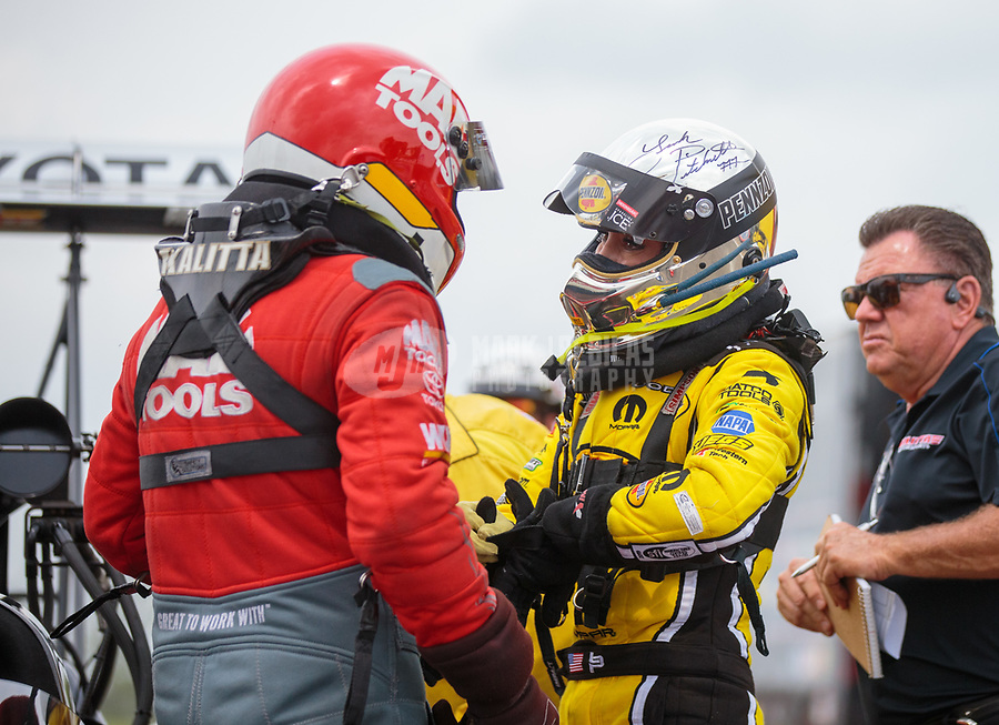Apr 13, 2019; Baytown, TX, USA; NHRA top fuel driver Leah Pritchett (right) talks with Doug Kalitta during qualifying for the Springnationals at Houston Raceway Park. Mandatory Credit: Mark J. Rebilas-USA TODAY Sports