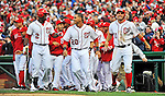 12 April 2012: Washington Nationals outfielder Roger Bernadina (2), shortstop Ian Desmond (20) and third baseman Ryan Zimmerman (11) are all smiles after Zimmerman slides home in the 10th inning for the game winning run against the Cincinnati Reds at Nationals Park in Washington, DC. The Nationals defeated the Reds 3-2 in 10 innings to take the first game of their 4-game series. Mandatory Credit: Ed Wolfstein Photo