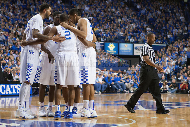 The Kentucky Wildcats huddle during the second half of the game against the Providence Friars at Rupp Arena on Sunday, November 30, 2014 in Lexington, Ky. Kentucky defeated Providence 58-38. Photo by Michael Reaves | Staff