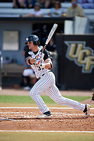 UCF Knights right fielder Dalton Wingo (35) follows through on a swing during a game against the Siena Saints on February 17, 2019 at John Euliano Park in Orlando, Florida.  UCF defeated Siena 7-1.  (Mike Janes/Four Seam Images)