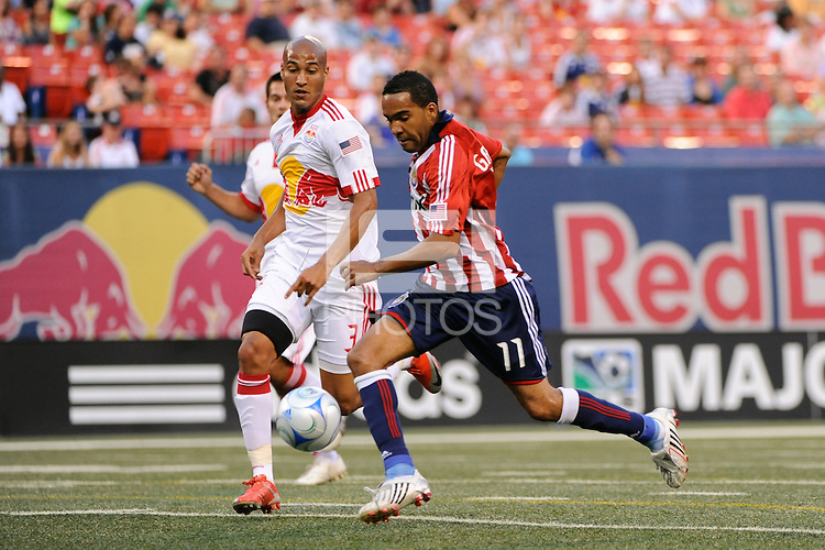 Maykel Galindo (11) of Chivas USA beats Carlos Johnson (3) of the New York Red Bulls moments before scoring during a Major League Soccer match at Giants Stadium in East Rutherford, NJ, on August 15, 2009.