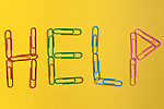 Word help spelled out with paper clips