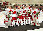 Wisconsin Badgers seniors from left to right, Alex Rigsby (33), Natalie Berg (28), Stefanie McKeough (5), Madison Packer (14), Kelly Jaminksi (7) and Ilana Friedman (31) prior to an NCAA college women's hockey game against the Minnesota Golden Gophers Friday, February 14, 2014 in Madison, Wis. The Golden Gophers won 3-2. (Photo by David Stluka)