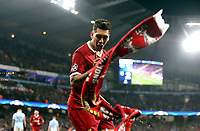 A scarf is thrown by the Liverpool fans as Liverpool's Roberto Firmino celebrates scoring his side's second goal <br /> <br /> Photographer Rich Linley/CameraSport<br /> <br /> UEFA Champions League Quarter-Final Second Leg - Manchester City v Liverpool - Tuesday 10th April 2018 - The Etihad - Manchester<br />  <br /> World Copyright &copy; 2017 CameraSport. All rights reserved. 43 Linden Ave. Countesthorpe. Leicester. England. LE8 5PG - Tel: +44 (0) 116 277 4147 - admin@camerasport.com - www.camerasport.com