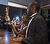 LUPITA NYONG'O AND FATHER PETER ANYANG'NYONG'O<br /> visit the engraving station at the Governor's Ball following the Oscar Ceremony, Dolby&reg; Theatre in Hollywood, Los Angeles_02/03/2014<br /> Mandatory Photo Credit: &copy;Harbaugh/Newspix International<br /> <br /> **ALL FEES PAYABLE TO: &quot;NEWSPIX INTERNATIONAL&quot;**<br /> <br /> PHOTO CREDIT MANDATORY!!: NEWSPIX INTERNATIONAL(Failure to credit will incur a surcharge of 100% of reproduction fees)<br /> <br /> IMMEDIATE CONFIRMATION OF USAGE REQUIRED:<br /> Newspix International, 31 Chinnery Hill, Bishop's Stortford, ENGLAND CM23 3PS<br /> Tel:+441279 324672  ; Fax: +441279656877<br /> Mobile:  0777568 1153<br /> e-mail: info@newspixinternational.co.uk
