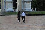 Couple flirting under the arch in Milan, Italy.