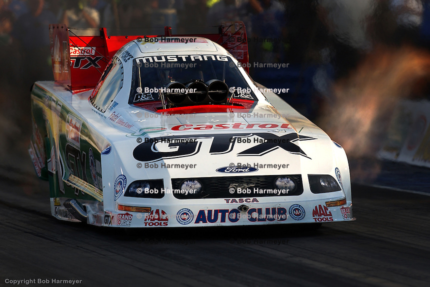 MADISON, IL - JUNE 25: John Force drives his Funny Car during the O'Reilly NHRA Midwest Nationals on June 25, 2006, at Gateway International Raceway near Madison, Illinois.