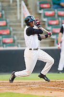 Kannapolis Intimidators shortstop Tim Anderson (2) follows through on his swing against the Greensboro Grasshoppers at CMC-Northeast Stadium on July 12, 2013 in Kannapolis, North Carolina.  The Grasshoppers defeated the Intimidators 2-1.   (Brian Westerholt/Four Seam Images)
