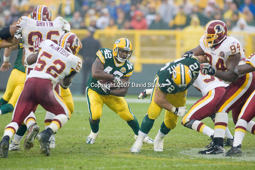 Running back  DeShawn Wynn #42 of the Green Bay Packers carries the ball during an NFL football game against the Washington Redskins at Lambeau Field on October 14, 2007 in Green Bay, Wisconsin. The Packers beat the Redskins 17-14. (Photo by David Stluka)