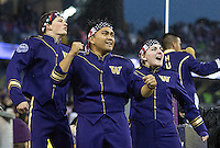 Members of the Husky Band's Siren Team get fired up prior to kickoff.