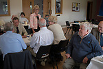 Priddy Friendly Society annual Club Walk Day. Somerset Uk 2019.<br /> John Dally President listens to Rhonda Gould club secretary at the after lunch speech.