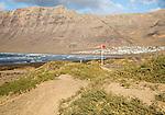 Red flag flying warning of bathing danger, La Caleta de Famara,Lanzarote, Canary islands, Spain