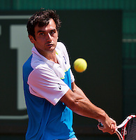 09-07-13, Netherlands, Scheveningen,  Mets, Tennis, Sport1 Open, day two, Florent Serra (FRA)<br /> <br /> <br /> Photo: Henk Koster