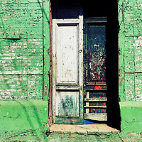 Paint-peeled doors are seen at the entrance to an unkept house, designed by using Spanish colonial architecture elements, built in a working class neighborhood of San Salvador, El Salvador, 10 November 2016.