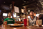 January 23, 2013. Durham, North Carolina. Jin Zhu (right) and Stephen Arena, Duke students and members of the Kappa Sigma fraternity, watched in disgust as Duke lost a 63-90 blowout to Miami. They and their frat brothers had gathered at Charlie's Pub and Grille to watch the game.. Duke University has become a power house in the national college basketball arena under the coaching of head coach Mike Krzyzewski. But the university has fought hard to maintain its image of high academic achievement while riding the wave of collegiate athletic success.