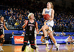 BROOKINGS, SD - FEBRUARY 8: Tori Nelson #20 of the South Dakota State Jackrabbits looses control of the ball as she drives to the basket against Claire Killian #11 of the Omaha Mavericks at Frost Arena February 8, 2020 in Brookings, South Dakota. (Photo by Dave Eggen/Inertia)